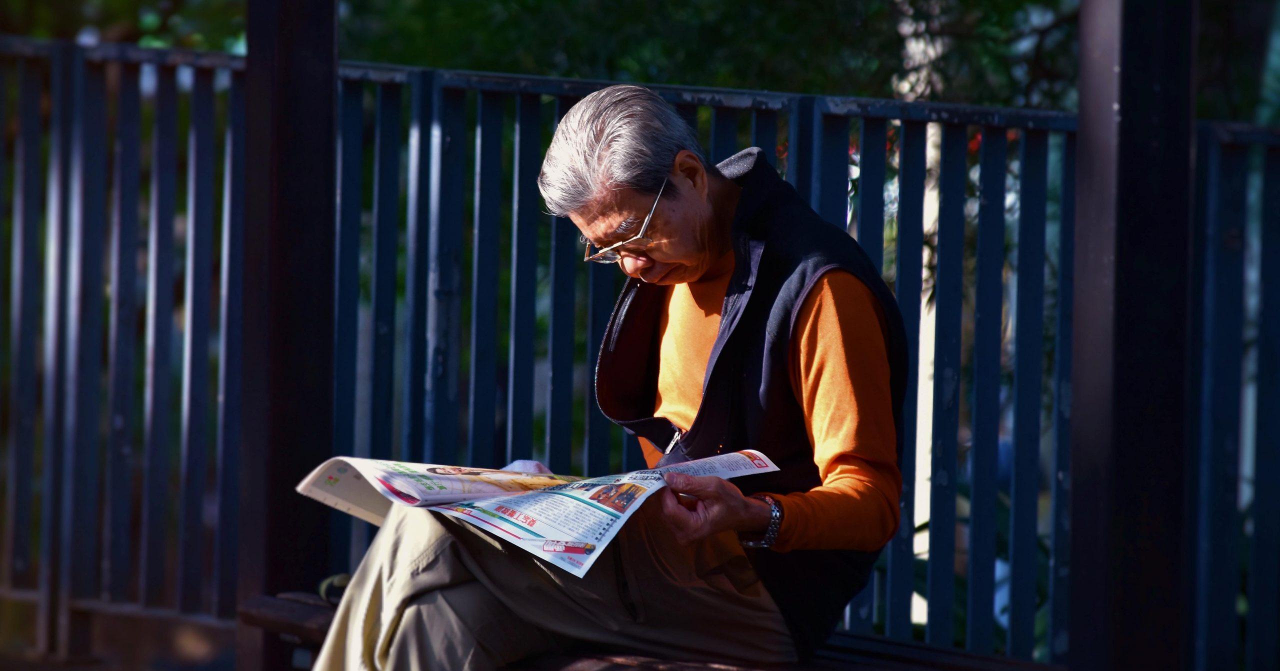 Old man reading newspapers (credit: mark-hang-fung)